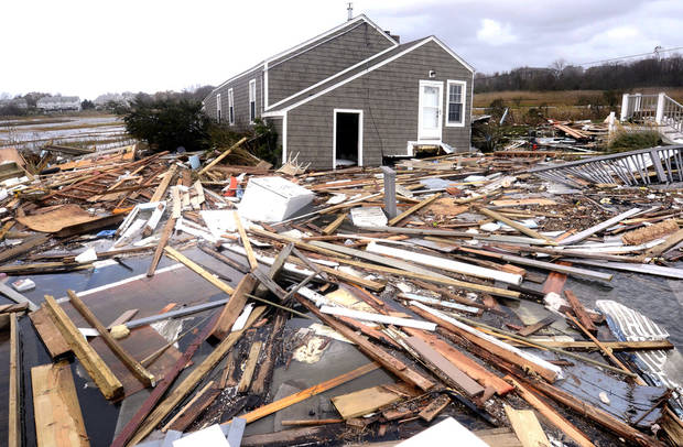 Debris floats around a house pushed off it's foundation in the aftermath of superstorm Sandy in East Haven, Conn., Tuesday, Oct. 30, 2012.  Sandy, the storm that made landfall Monday, caused multiple fatalities, halted mass transit and cut power to more than 6 million homes and businesses. (AP Photo/Jessica Hill) ORG XMIT: CTJH111