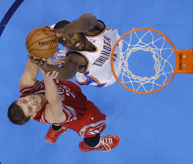 Oklahoma City's Serge Ibaka (9) fights for a rebound with Houston's Chandler Parsons (25) during Game 2 in the first round of the NBA playoffs between the Oklahoma City Thunder and the Houston Rockets at Chesapeake Energy Arena in Oklahoma City, Wednesday, April 24, 2013. Photo by Chris Landsberger, The Oklahoman