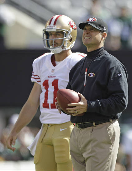 San Francisco 49ers quarterback Alex Smith and head coach Jim Harbaugh look on before an NFL football game against the New York Jets Sunday, Sept. 30, 2012, in East Rutherford, N.J. (AP Photo/Kathy Willens)