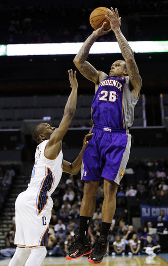 Phoenix Suns' Shannon Brown (26) shoots over Charlotte Bobcats' Kemba Walker (15) during the second half of an NBA basketball game in Charlotte, N.C., Wednesday, Nov. 7, 2012. Phoenix won 117-110. (AP Photo/Chuck Burton)