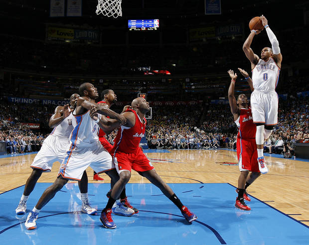 Oklahoma City's Russell Westbrook (0) shoots the ball over the Clippers Chris Paul (3) during an NBA basketball game between the Oklahoma City Thunder and the Los Angeles Clippers at Chesapeake Energy Arena in Oklahoma City, Wednesday, Nov. 21, 2012. Photo by Bryan Terry, The Oklahoman