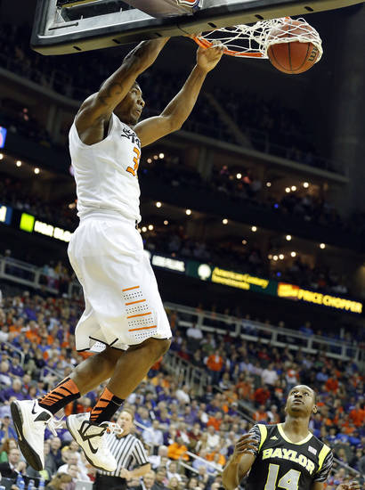Oklahoma State's Marcus Smart (33) dunks the ball in front of Baylor's Deuce Bello (14)  during the Phillips 66 Big 12 Men's basketball championship tournament game between Oklahoma State University and Baylor at the Sprint Center in Kansas City, Thursday, March 14, 2013. Photo by Sarah Phipps, The Oklahoman