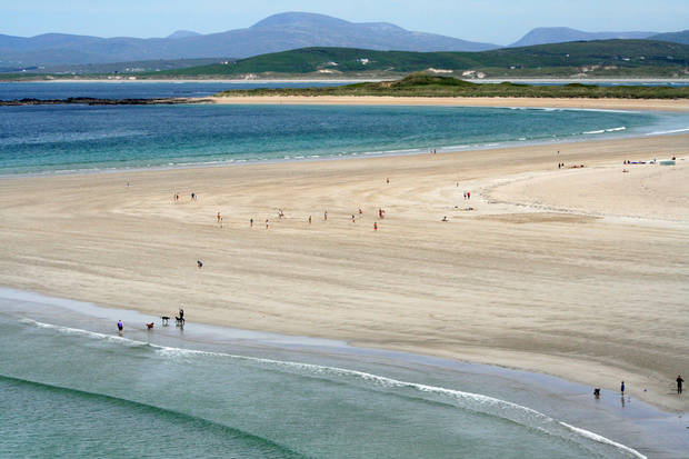 This June 2, 2012, photo shows the swirls of sand, land and sea at the Portnoo Strand in County Donegal, Ireland. Ireland is about 300 miles from north to south and a driving trip in the country's western region takes you along hilly, narrow roads with spectacular views ranging from seaside cliffs to verdant farmland (AP Photo/Jake Coyle)