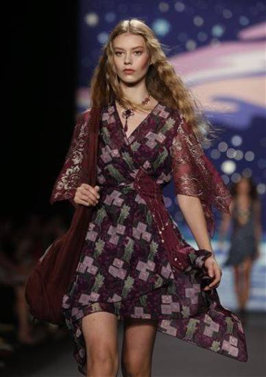 The Anna Sui Spring 2014 collection is modeled during Fashion Week, Wednesday, Sept. 11, 2013, in New York. (AP Photo/Jason DeCrow)