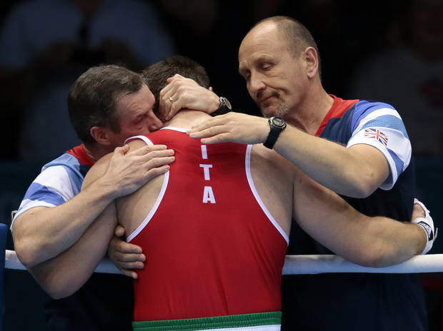 Italy's Roberto Cammarelle reacts after losing to Britain's Anthony Joshua in a super heavyweight over 91-kg gold medal boxing match at the 2012 Summer Olympics, Sunday, Aug. 12, 2012, in London. (AP Photo/Ivan Sekretarev)