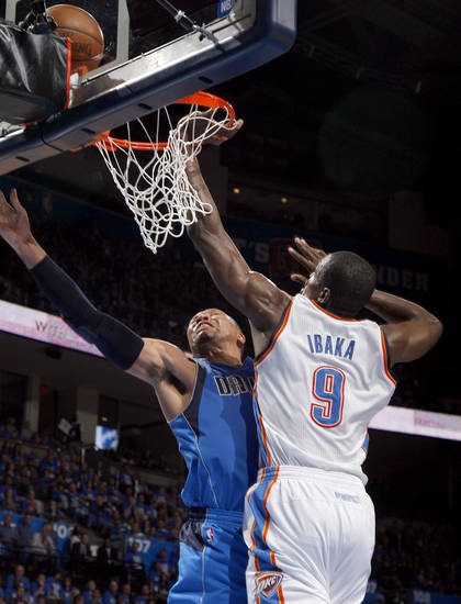 Oklahoma City's Serge Ibaka (9) defends against Dallas' Shawn Marion (0) during game one of the first round in the NBA playoffs between the Oklahoma City Thunder and the Dallas Mavericks at Chesapeake Energy Arena in Oklahoma City, Saturday, April 28, 2012. Photo by Sarah Phipps, The Oklahoman