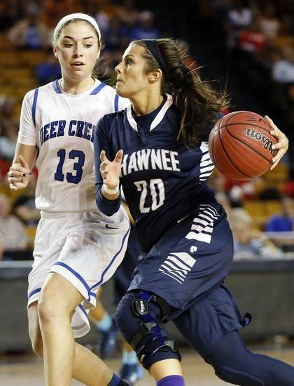 Shawnee's McKenzie Cooper (20) takes the ball past Deer Creek's Whitney Jones (13) during a Class 5A girls semifinal high school basketball game in the state championship tournament between Deer Creek and Shawnee at the Mabee Center in Tulsa, Okla., Friday, March 14, 2014. Deer Creek won, 33-29. Photo by Nate Billings, The Oklahoman