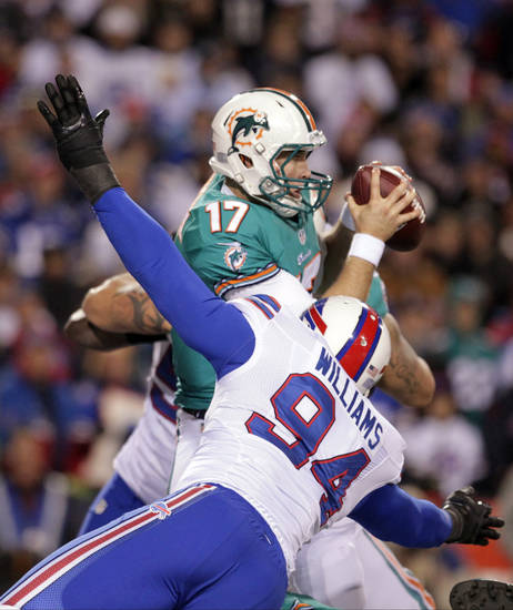 Buffalo Bills defensive end Mario Williams (94) sacks Miami Dolphins quarterback Ryan Tannehill (17) during the first half of an NFL football game on Thursday, Nov. 15, 2012, in Orchard Park, N.Y. (AP Photo/Bill Wippert)