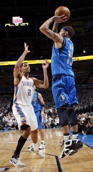 Dallas' Delonte West (13) shoots over Oklahoma City's Thabo Sefolosha (2) during Game 2 of the first round in the NBA basketball  playoffs between the Oklahoma City Thunder and the Dallas Mavericks at Chesapeake Energy Arena in Oklahoma City, Monday, April 30, 2012. Photo by Nate Billings, The Oklahoman