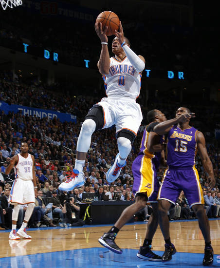 Oklahoma City's Russell Westbrook goes past Los Angeles' Metta World Peace, left, and Dwight howard during an NBA basketball game between the Oklahoma City Thunder and the Los Angeles Lakers at Chesapeake Energy Arena in Oklahoma City, Tuesday, March 5, 2013. Photo by Bryan Terry, The Oklahoman