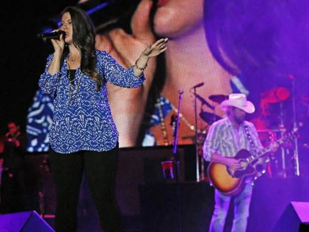 Krystal Keith performs with her father, Toby Keith, during the Oklahoma Twister Relief Concert, benefiting victims of the May tornadoes, at Gaylord Family - Oklahoma Memorial Stadium on the campus of the University of Oklahoma in Norman, Okla., Saturday, July 6, 2013. Krystal Keith also performed the national anthem at the show. Photo by Nate Billings, The Oklahoman