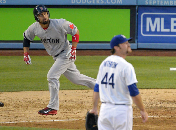 Boston Red Sox's Shane Victorino, left, watches his ball go out for a solo home run along with Los Angeles Dodgers relief pitcher Chris Withrow during the seventh inning of their baseball game, Sunday, Aug. 25, 2013, in Los Angeles.  (AP Photo/Mark J. Terrill)
