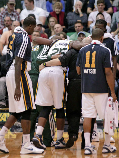 Utah Jazz center Al Jefferson (25) is helped off the court after being injured in the fourth quarter during an NBA basketball game against the Orlando Magic Wednesday, Dec. 5, 2012, in Salt Lake City. The Jazz defeated the Magic 87-81. (AP Photo/Rick Bowmer)