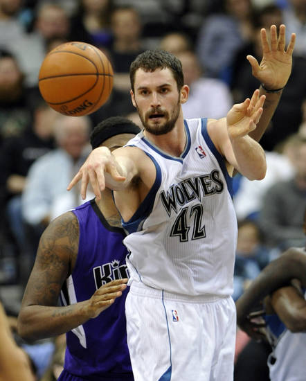   FILE - In this Jan. 16, 2012, file photo, Minnesota Timberwolves&#039; Kevin Love pass the ball during the second half of an NBA basketball game against the Sacramento Kings in Minneapolis. Love will miss the next six to eight weeks after breaking his right hand in a workout on Wednesday, Oct. 17, 2012. (AP Photo/ Jim Mone, File)  