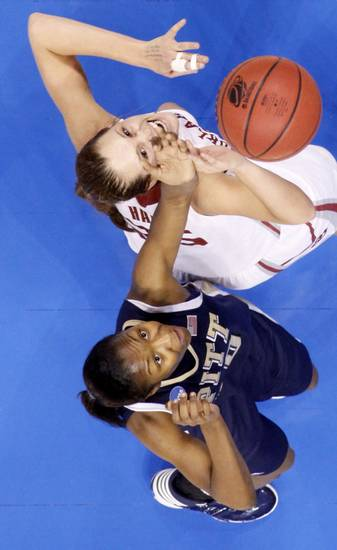 OU's Whitney Hand and Pittsburgh's Taneisha Harrison during the NCAA women's basketball tournament game between Oklahoma and Pittsburgh at the Ford Center in Oklahoma City, Sunday, March 29, 2009.  PHOTO BY BRYAN TERRY, THE OKLAHOMAN