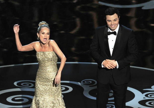 Host Seth MacFarlane, right, and actress Kristin Chenoweth perform a song dedicated to the �losers� during the Feb. 24 finale of the Oscars at the Dolby Theatre in Los Angeles. AP FILE PHOTO