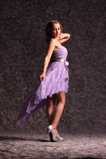 Model Ashlin  wears a lavender hi-low dress with lace bodice and sweetheart neckline by Teeze Me,  $89. Metallic silver peep-toe pump from Rampage, $49.99. All sold at Macy's. Photo by Steve Webb, for The Oklahoman.   <strong></strong>