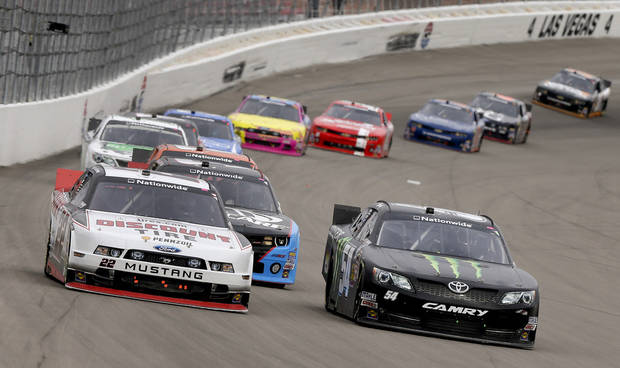 Brad Keselowski (22) and Kyle Busch (54) vie for the fifth position coming out of Turn 4 during the NASCAR Nationwide Series auto race, Saturday, March 9, 2013, in Las Vegas. (AP Photo/Julie Jacobson)