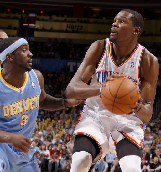 /tok35n/ looks to shoot beside Denver's Ty Lawson (3) during the NBA basketball game between the Oklahoma City Thunder and the Denver Nuggets at Chesapeake Energy Arena in Oklahoma City, Wednesday, April 25, 2012. Oklahoma City lost 106-101.  Photo by Bryan Terry, The Oklahoman