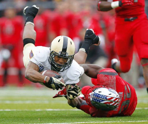Army running back Malcolm Brown (23) is tackled by Rutgers Duron Harmon (32) after making a catch for a first down during the second quarter of an NCAA college football game in Piscataway, N.J., Saturday, Nov. 10, 2012. (AP Photo/Rich Schultz)