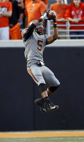 Oklahoma State's Josh Stewart (5) catches a pass in the third quarter during a college football game between Oklahoma State University (OSU) and the West Virginia University at Boone Pickens Stadium in Stillwater, Okla., Saturday, Nov. 10, 2012. Photo by Sarah Phipps, The Oklahoman