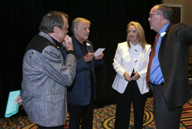 Kim Williams, left; Larry Henley, second from left; Mary Chapin Carpenter, second from right; and Tony Arata, right; talk before they are inducted into the Nashville Songwriters Hall of Fame on Sunday, Oct. 7, 2012, in Nashville, Tenn. (AP Photo/Mark Humphrey)