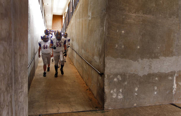 Anadarko makes their way to the field during the Class 4A Oklahoma state championship football game between Anadarko and Clinton at Boone Pickens Stadium on Saturday, Dec. 1, 2012, in Stillwater, Okla.   Photo by Chris Landsberger, The Oklahoman