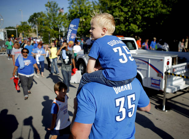 Bryan Scagnetti of Oklahoma City carries his son, Preston Scagnetti, 3, outside the arena before Game 4 of the Western Conference Finals between the Oklahoma City Thunder and the San Antonio Spurs in the NBA Playoffs at the Chesapeake Energy Arena on Saturday, June 2, 2012. Photo by Bryan Terry/The Oklahoman