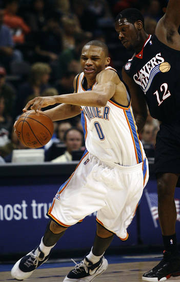Oklahoma City Thunder guard Russell Westbrook, left, drives around Philadelphia 76ers guard Royal Ivey, right, in the fourth quarter of an NBA basketball game in Oklahoma City, Sunday, March 8, 2009. Oklahoma City won the game 89-74. (AP Photo/Sue Ogrocki) ORG XMIT: OKSO107