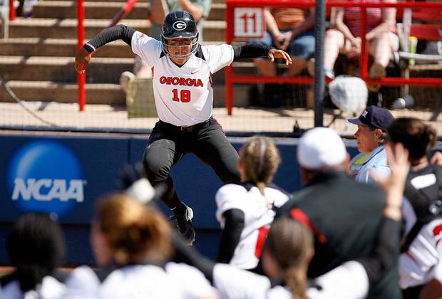 Georgia's Lisaira Daniels celebrates at home plate after scoring the winning run during NCAA softball tournament game between the Washington and Georgia, Sunday May 31, 2008. Photo by Sarah Phipps, The Oklahoman