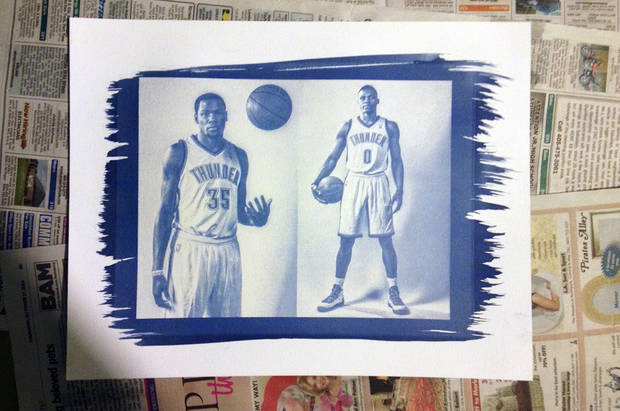 A dried cyanotype of Kevin Durant and Russell Westbrook. The unique border on the print is caused by brushing on the chemicals to the paper.