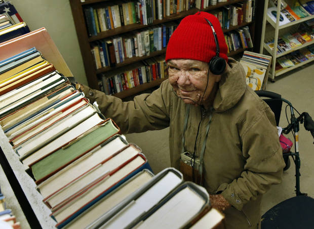 Emiley Sandefer sorts books for resale at ReRun Junction, a thrift shop operated by disabled adults at 325 E Comanche St. in Norman.  PHOTO BY STEVE SISNEY, THE OKLAHOMAN