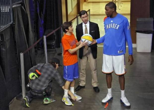 Oklahoma City Thunder's Kevin Durant works with actors Taylor Gray, left, and Timothy Fall as a member of the crew marks spots on the set of his movie 'Thunderstruck' inside the Chesapeake Energy Arena on Tuesday, Jan. 24, 2012, in Oklahoma City, Okla. Photo by Chris Landsberger, The Oklahoman