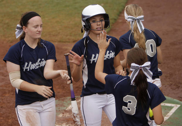 Edmond North's Paige Bond (7) celebrates with her teammates after scoring a run during a 6A state softball semifinals game between Edmond North and Yukon at ASA Hall of Fame Stadium in Oklahoma City, Okla., Friday, Oct. 12, 2012.  Photo by Garett Fisbeck, The Oklahoman