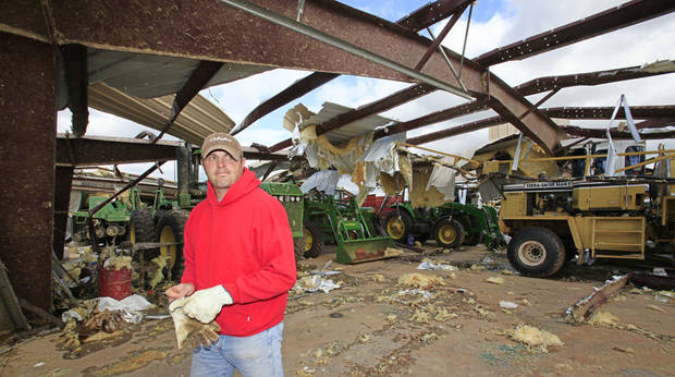 Tornado aftermath cleanup east of Piedmont, Wednesday, May 25, 2011. Kiley Witte , 34, looks over his barn that was hit by Tuesdays tornado.  Photo by David McDaniel, The Oklahoman