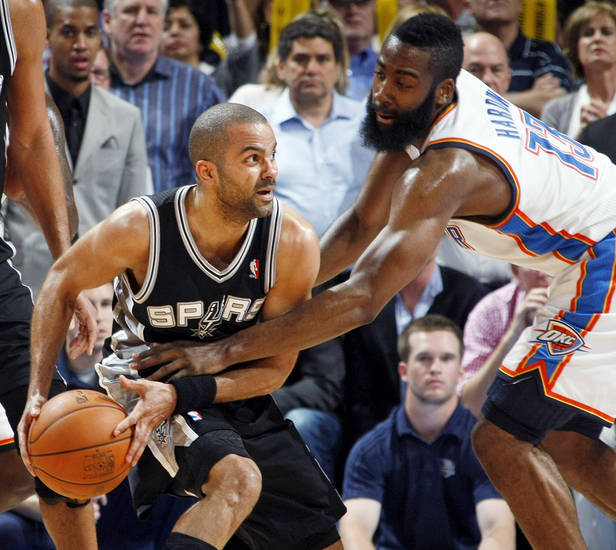 Oklahoma City&#039;s James Harden (13) pressures San Antonio&#039;s Tony Parker (9) during the NBA basketball game between the Oklahoma City Thunder and the San Antonio Spurs at Chesapeake Energy Arena in Oklahoma City, Friday, March 16, 2012. San Antonio won, 114-105. Photo by Nate Billings, The Oklahoman