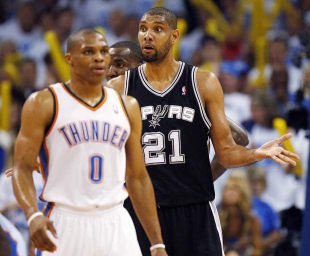 San Antonio's Tim Duncan (21) looks to the Spurs' bench for an answer behind Oklahoma City's Russell Westbrook (0) in the second half during Game 4 of the Western Conference Finals between the Oklahoma City Thunder and the San Antonio Spurs in the NBA playoffs at the Chesapeake Energy Arena in Oklahoma City, Saturday, June 2, 2012. Oklahoma City won, 109-103. Photo by Nate Billings, The Oklahoman