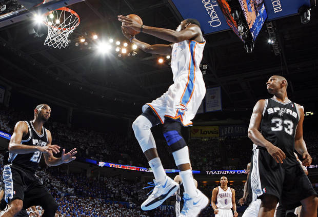 Oklahoma City's Kevin Durant (35) moves to the hoop between San Antonio's Tim Duncan (21) and Boris Diaw (33) during Game 4 of the Western Conference Finals between the Oklahoma City Thunder and the San Antonio Spurs in the NBA playoffs at the Chesapeake Energy Arena in Oklahoma City, Saturday, June 2, 2012. Oklahoma City won, 109-103. Photo by Nate Billings, The Oklahoman
