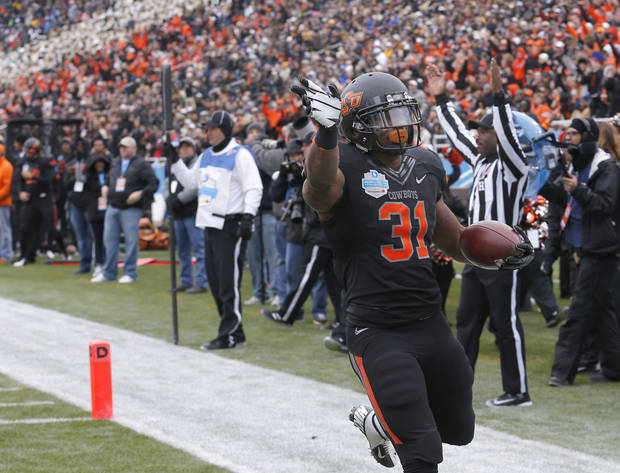 Oklahoma State's Jeremy Smith (31) celebrates a touchdown during the Heart of Dallas Bowl football game between the Oklahoma State University (OSU) and Purdue University at the Cotton Bowl in Dallas,  Tuesday,Jan. 1, 2013. Photo by Sarah Phipps, The Oklahoman
