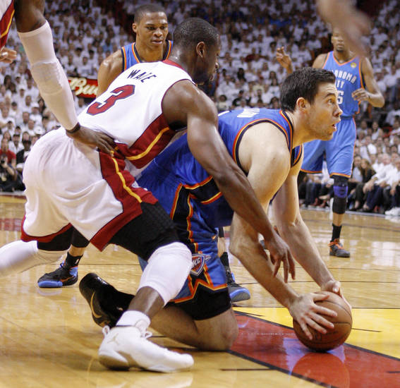 Oklahoma City's Nick Collison (4) looks to pass as Miami's Dwyane Wade (3) defends during Game 4 of the NBA Finals between the Oklahoma City Thunder and the Miami Heat at American Airlines Arena, Tuesday, June 19, 2012. Photo by Bryan Terry, The Oklahoman