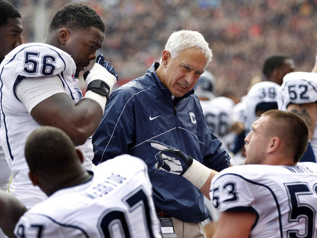 Connecticut head coach Paul Pasqualoni talks to his players during the first half of an NCAA college football game against Rutgers in Piscataway, N.J., Saturday, Oct. 6, 2012. (AP Photo/Mel Evans)