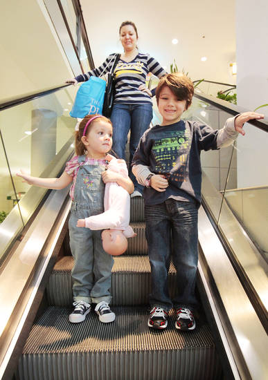 Jennifer Stephens and her children Natalie, 3, and Tyler, 6, shop at Quail Springs Mall, Monday, December 26, 2011.   Photo by David McDaniel, The Oklahoman