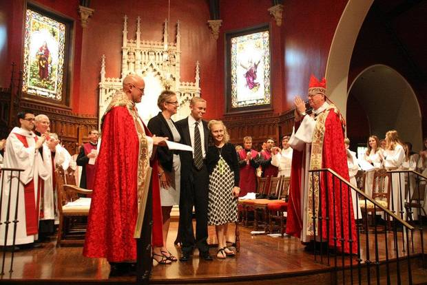 At St. Paul's Episcopal Cathedral, 127 NW 7, the Rev. Justin Lindstrom, the cathedral's dean, his wife Susan, son Covell and daughter Cooper participate in Lindstrom's recent installation service with Bishop Edward Konieczny, at right, presiding. Photo provided  <strong></strong>