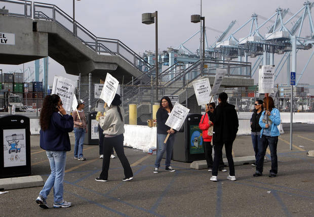 Striking protestors are shown at the Port of Los Angeles Wednesday Nov. 28, 2012 in Los Angeles. Striking workers shut down the largest terminal at the Port of Los Angeles for a second day on Wednesday, ignoring an arbitrator's order to return to work and raising the possibility of a larger job action that could paralyze the nation's busiest port complex. (AP Photo/Nick Ut)
