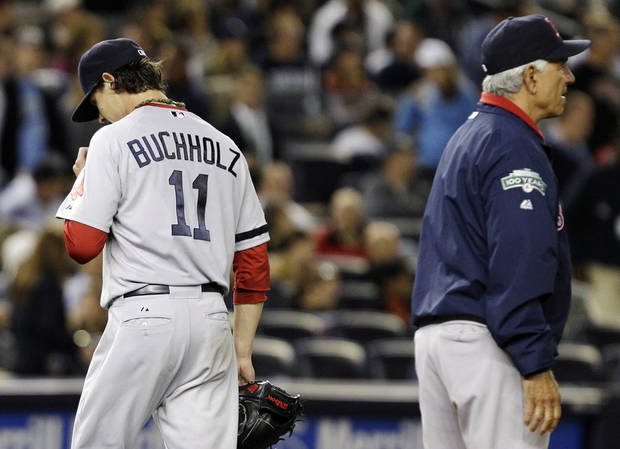 Boston Red Sox starting pitcher Clay Buchholz, left, leaves the mound as manager Bobby Valentine summons a reliever during the second inning of their baseball game against the New York Yankees at Yankee Stadium in New York, Monday, Oct. 1, 2012. (AP Photo/Kathy Willens)