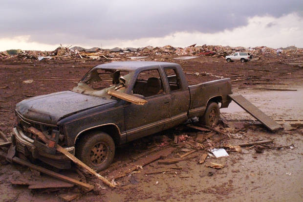 May 3, 1999, Oklahoma City Tornado:  Tornado damage: A destroyed pickup in front of a line of dozens of leveled homes in the Country Place Estates housing addition SW of 134th and S. Penn.  Staff Photo by Paul Hellstern