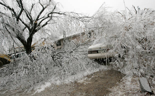 WINTER / COLD / WEATHER / ICE STORM 2007, DAMAGE: Downed trees lay over a car in during a winter storm, in Carney, Okla., Tuesday, December 11, 2007. By Matt Strasen, The Oklahoman ORG XMIT: KOD