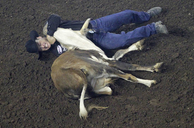 Kyle Whitaker, of Chambers, Neb., competes in steer wrestling during the Ram National Circuit Finals Rodeo Championship in Oklahoma City, Sunday, April 1, 2012.  Photo by Garett Fisbeck, For The Oklahoman