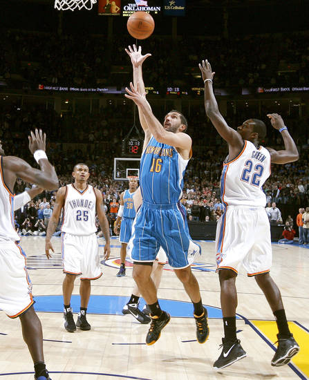 Peja Stojakovic of New Orlean shoots the ball between Oklahoma City's Earl Watson and Jeff Green during the NBA basketball game between the Oklahoma City Thunder and the New Orleans Hornets at the Ford Center in Oklahoma City on Friday, Nov. 21, 2008.  BY BRYAN TERRY, THE OKLAHOMAN