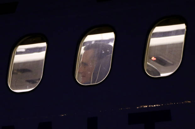 Republican presidential candidate and former Massachusetts Gov. Mitt Romney arrives on his campaign plane at Boston's Logan Airport, Tuesday, Nov. 6, 2012. (AP Photo/Charles Dharapak)